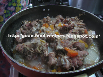 Boil the meat with Onions and Tomato