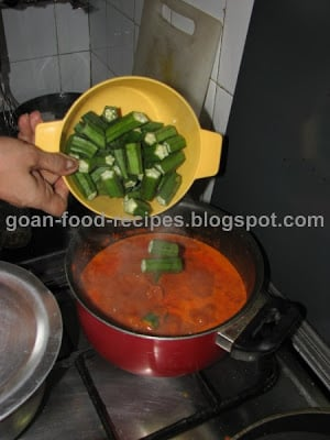 Let it come to a boil and then add the lady fingers