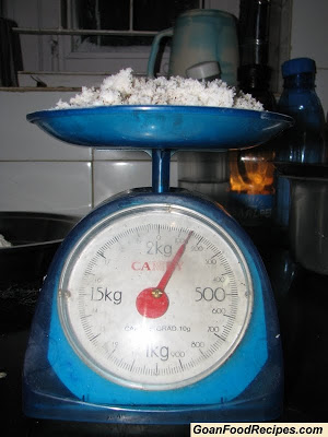 weighing scraped coconut